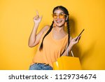 beautiful young woman with... | Shutterstock . vector #1129734674