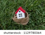 real estate agent and mortgage... | Shutterstock . vector #1129780364