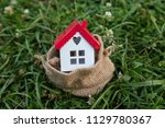 real estate agent and mortgage... | Shutterstock . vector #1129780367