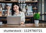 close up an asian girl is... | Shutterstock . vector #1129780721