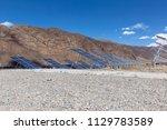 a solar power station under... | Shutterstock . vector #1129783589