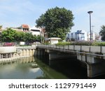 Small photo of JAKARTA, INDONESIA - July 7, 2018: Pedestrian bridge on Krukut River Kali Besar in Kota Tua.