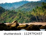 beautiful and relaxing beach... | Shutterstock . vector #1129792457