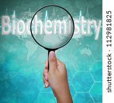 Biochemistry, word in Magnifying glass , background medical - stock photo