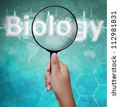 Biology, word in Magnifying glass , background medical - stock photo