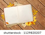 old book and autumn leaves on... | Shutterstock . vector #1129820207