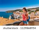 tourist woman in cadaques ... | Shutterstock . vector #1129868954