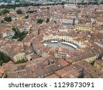 amphitheater square in lucca... | Shutterstock . vector #1129873091