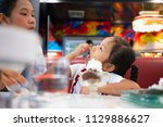 asian mom and daughter in ice...   Shutterstock . vector #1129886627