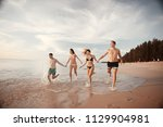 lovers run along the beach  ... | Shutterstock . vector #1129904981