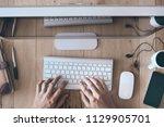 man hand working on computer | Shutterstock . vector #1129905701