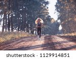 summer girl running nature  ... | Shutterstock . vector #1129914851