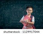 smart educated school kid... | Shutterstock . vector #1129917044