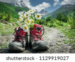 hiking boots and mountains... | Shutterstock . vector #1129919027