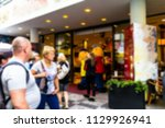 crowd of people in streets of... | Shutterstock . vector #1129926941