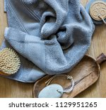 pure grey towel with body brush ... | Shutterstock . vector #1129951265