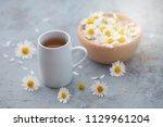 chamomile tea with fresh... | Shutterstock . vector #1129961204