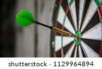 Stock photo an image of a typical darts game with dart in the bullseye 1129964894