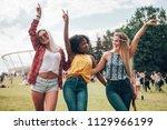 group of friends at summer... | Shutterstock . vector #1129966199