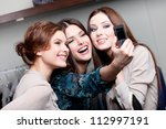 Small photo of Happy girls photo session on the cellphone after purchasing