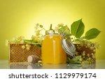 jar of honey  wooden frame with ... | Shutterstock . vector #1129979174