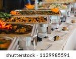 catering wedding buffet for... | Shutterstock . vector #1129985591