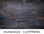 Stock photo bbq background burnt wooden board texture burned scratched hardwood surface smoking wood plank 1129998581