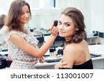 make up artist applying powder... | Shutterstock . vector #113001007