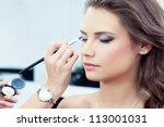 make up artist applying bright... | Shutterstock . vector #113001031