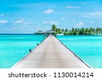 Pier At Maldives. Blue Water ...