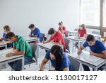 high school students doing an... | Shutterstock . vector #1130017127