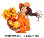 Woman holding autumn basket with fruit and vegetable. - stock photo