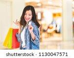 happy beautiful asian woman... | Shutterstock . vector #1130047571