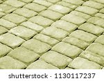cobble stone pavement in yellow ... | Shutterstock . vector #1130117237