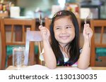 asian children cute hungry or... | Shutterstock . vector #1130130035