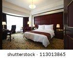 hotel bedroom | Shutterstock . vector #113013865