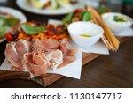 delicious prosciutto di parma... | Shutterstock . vector #1130147717