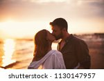 attractive couple kissing on a... | Shutterstock . vector #1130147957