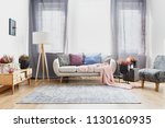 grey curtains behind sofa with... | Shutterstock . vector #1130160935