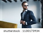 young bearded stylish... | Shutterstock . vector #1130173934