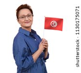 tunisia flag. woman holding... | Shutterstock . vector #1130175071
