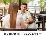 two people in cafe enjoying the ... | Shutterstock . vector #1130179649
