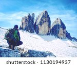 man hiker with backpack on the... | Shutterstock . vector #1130194937