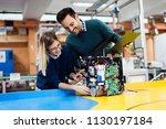 young students of robotics... | Shutterstock . vector #1130197184