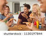 cheerful friends enjoying pizza ... | Shutterstock . vector #1130197844