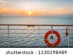 red lifebuoy on safety railing... | Shutterstock . vector #1130198489