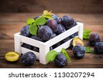fresh organic plums in the crate | Shutterstock . vector #1130207294