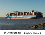 Small photo of Stade, Germany - July 8, 2018: Ultra-large container ship COSCO Shipping Virgo on Elbe river. The vessel is 400m long and holds up to 20,000 TEU. It was delivered in May, 2018.