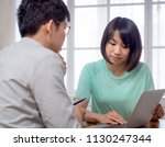 two young people discussing... | Shutterstock . vector #1130247344