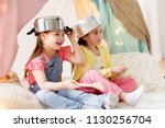 childhood and hygge concept  ... | Shutterstock . vector #1130256704